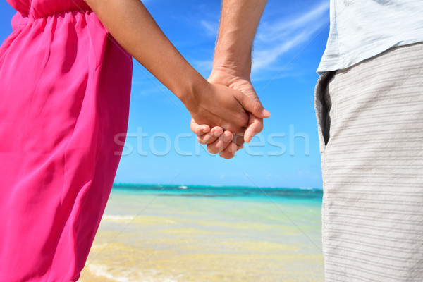 Stock photo: Holding hands romantic newlyweds couple on beach