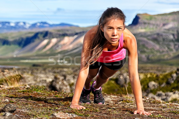 Stock photo: Fitness push-ups woman doing pushups outdoors