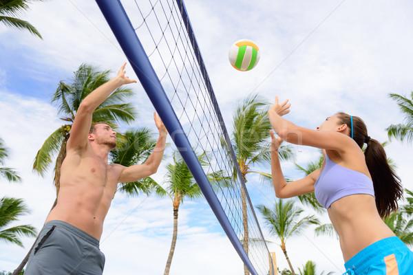 Amigos jogar praia voleibol esportes mulher Foto stock © Maridav