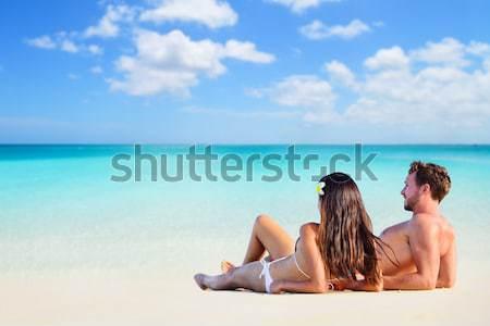 Sexy beach bikini body woman relaxing sun tanning Stock photo © Maridav