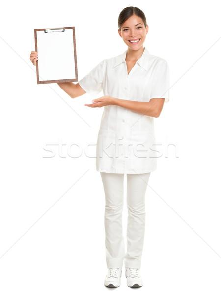 Foto stock: Enfermeira · clipboard · assinar · médico · mulher