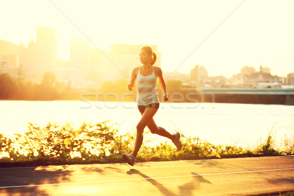 female runner running at sunset Stock photo © Maridav