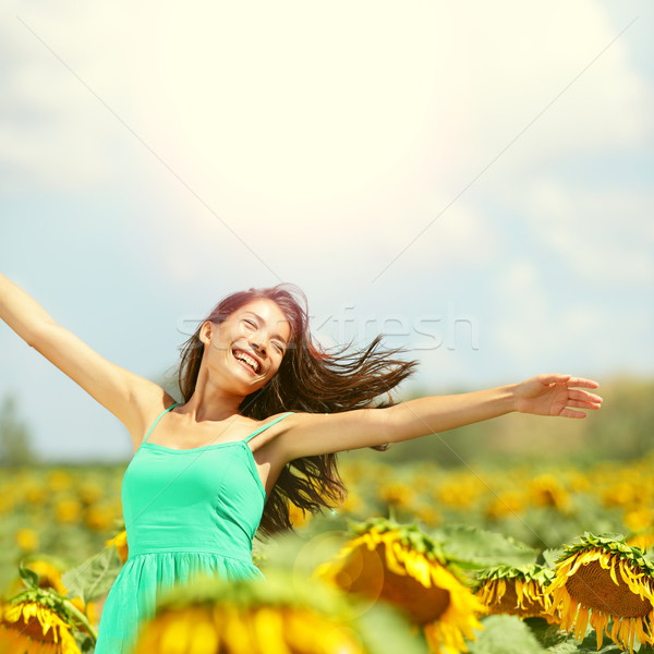 Happy woman in sunflower field Stock photo © Maridav
