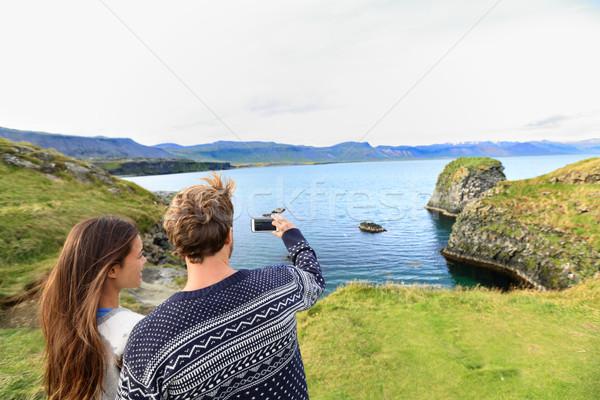 Tourists on travel taking photo on Iceland Stock photo © Maridav