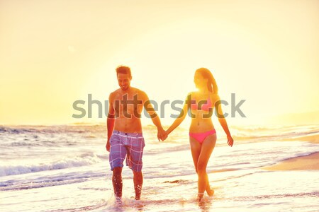Stock photo: Romantic honeymoon couple in love at beach sunset