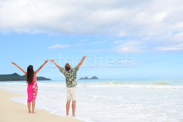 Happy freedom couple on Hawaiian beach vacations Stock photo © Maridav