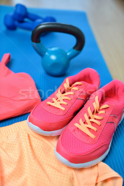 Gym shoes - Fitness outfit closeup with kettlebell Stock photo © Maridav