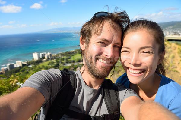Selfie couple travel fun with Honolulu Hawaii Stock photo © Maridav