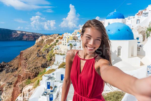 Europe travel selfie Asian woman in Oia Santorini Stock photo © Maridav