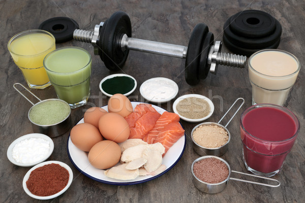 Súlyzós edzés felszerlés étel kiegészítők test építők Stock fotó © marilyna