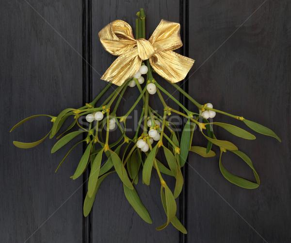 Maretak goud lint boeg donkere hout Stockfoto © marilyna