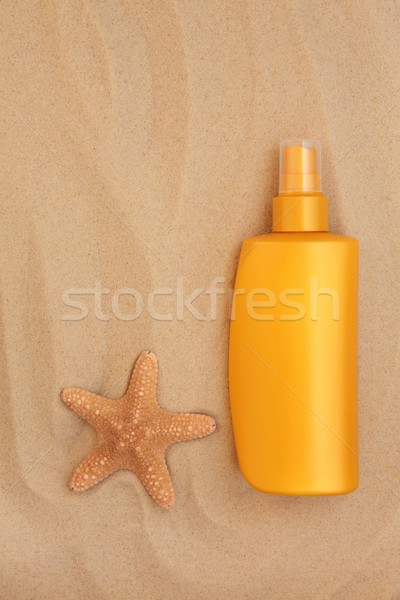 Protetor solar garrafa starfish concha areia saúde Foto stock © marilyna
