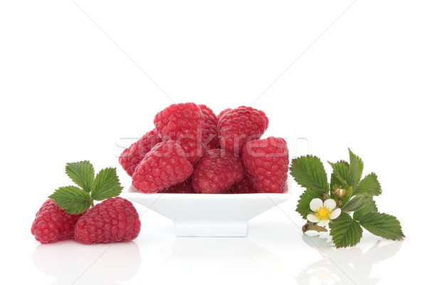 Raspberries and Flower Leaf Sprigs Stock photo © marilyna