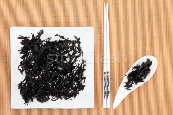 Hínár fehér tányér edény bambusz evőpálcikák Stock fotó © marilyna