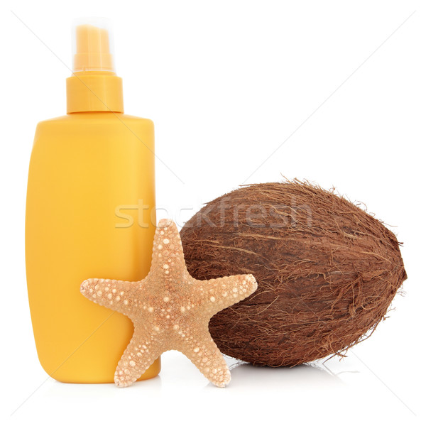 Bronzage lotion bouteille coco starfish shell Photo stock © marilyna