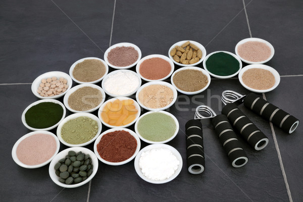 Body Building Supplements and Hand Grippers Stock photo © marilyna