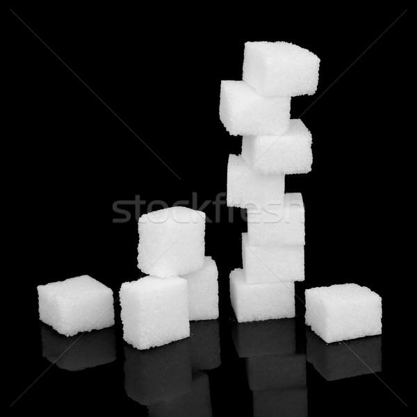 Blanco azúcar riesgo terrones de azúcar negro alimentos Foto stock © marilyna