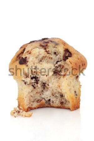 Chocolat puce muffin mordre sur détacher Photo stock © marilyna