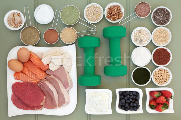 Super Food and Dumbbells for Body Builders Stock photo © marilyna