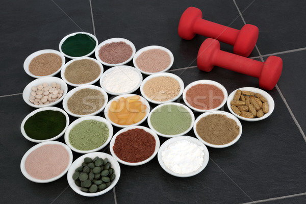 Body Building Powders and Vitamin Pills Stock photo © marilyna