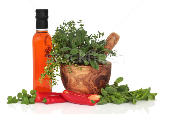 Olive Chilli Oil, Chillies and Herb Leaves Stock photo © marilyna