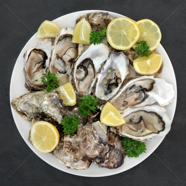 Oysters Lemon and Parsley  Stock photo © marilyna