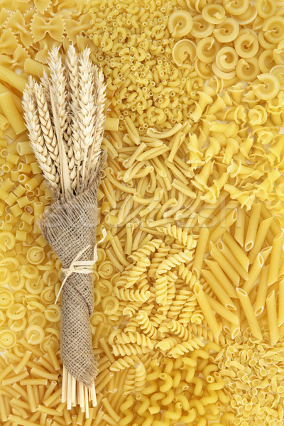 Dried Pasta and Wheat Background Stock photo © marilyna
