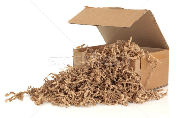 Cardboard shipping box with recycled brown paper protective filler, isolated over white background. Stock photo © marilyna