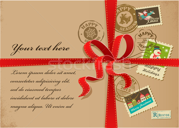 Christmas gift with red ribbon and vintage postage stamps Stock photo © marish