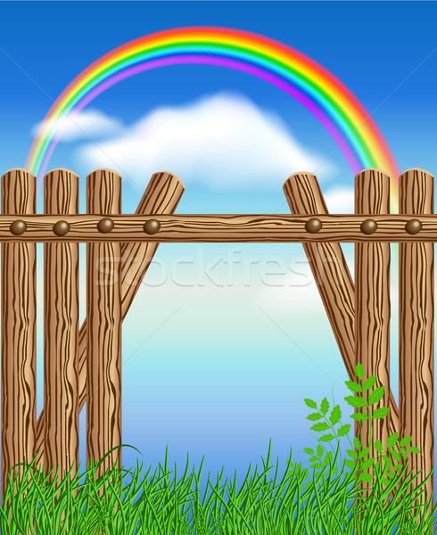 Legno recinzione erba verde Rainbow cielo primavera Foto d'archivio © Marisha