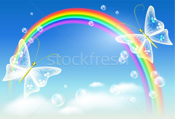 Rainbow farfalla cielo nubi blu volare Foto d'archivio © Marisha