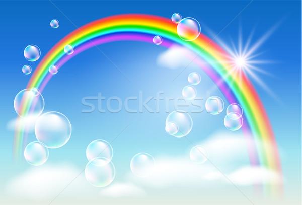 Rainbow nubi bolle cielo sole blu Foto d'archivio © Marisha