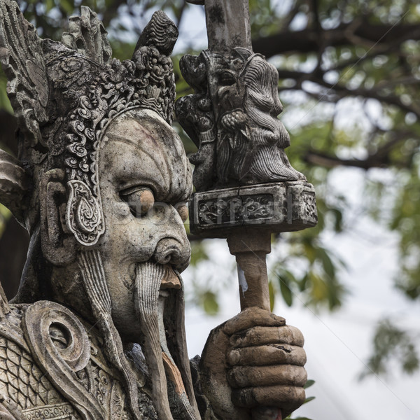 Statue of a Chinese warrior near an entrance of Wat Pho. Wat Pho Stock photo © Mariusz_Prusaczyk