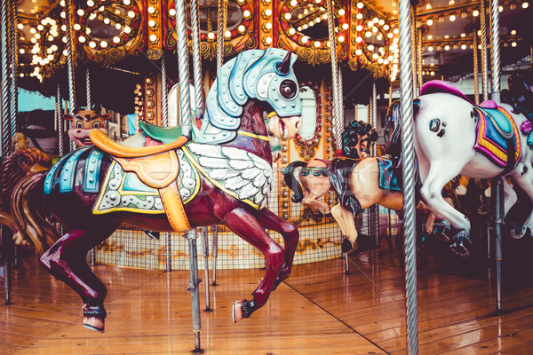 Old French carousel in a holiday park. Three horses and airplane on a traditional fairground vintage Stock photo © Mariusz_Prusaczyk