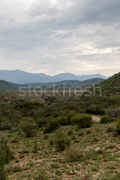 Portrait mur nuageux montagnes coucher du soleil nature Photo stock © markdescande