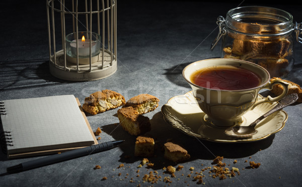 Cup of tea , almond cookies and notebook. Stock photo © markova64el