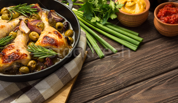 Dinner with baked chicken legs and vegetable.  Stock photo © markova64el