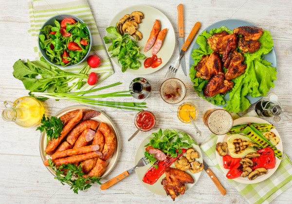 Dinner table with variety food Stock photo © markova64el