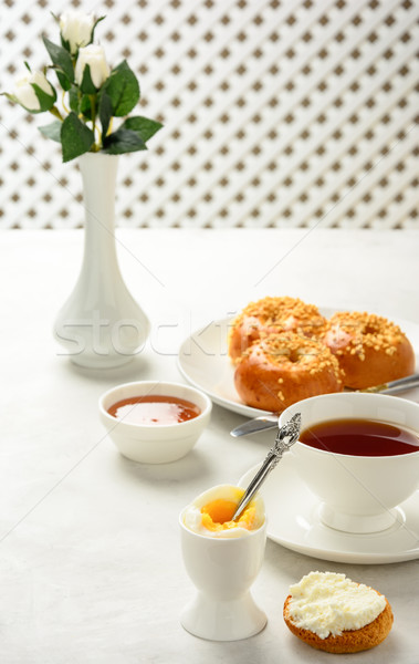 Breakfast of boiled egg and brioche buns with tea  Stock photo © markova64el
