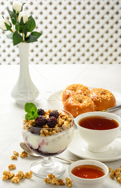 Breakfast of granola, buns brioche, honey and black tea . Stock photo © markova64el