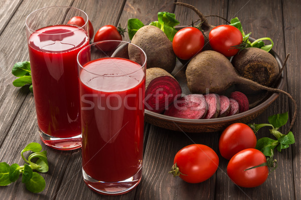 Beet-tomato juice with vegetables on dark wooden background Stock photo © markova64el