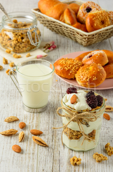 Healthy breakfast ingredients on a white wooden table. Stock photo © markova64el
