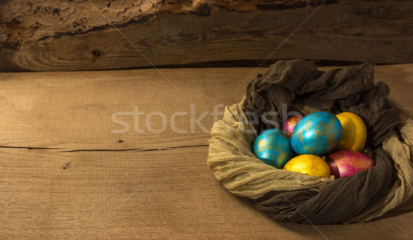 Easter eggs ion a natural wooden background. Copy space. Stock photo © markova64el