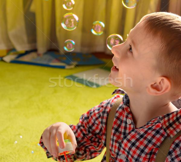 Gyermek szappanbuborékok mosolyog baba boldog természet Stock fotó © markova64el