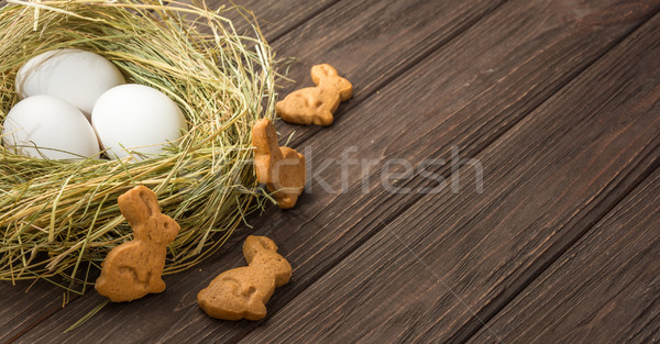 Easter eggs in a straw nest and cookies Stock photo © markova64el