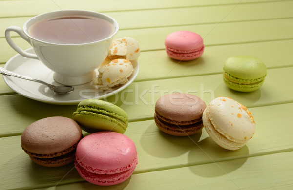 Macaroons and cup of tea on a wooden table. Stock photo © markova64el