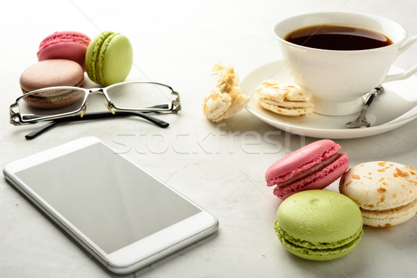 Tea with macaroons, smartphone and glasses  Stock photo © markova64el