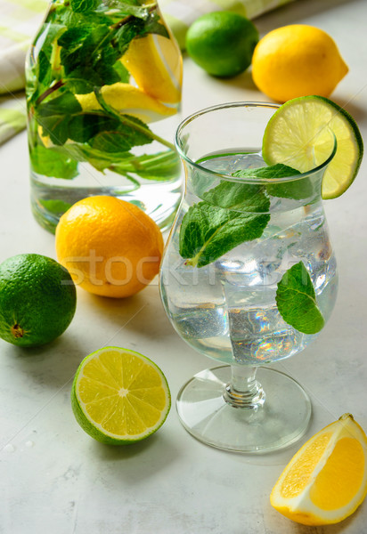 lemonade in a glass on a white background. Stock photo © markova64el