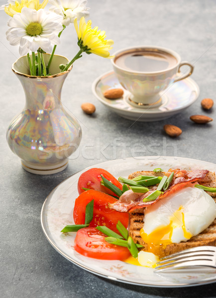 Breakfast with egg poached, toasted, bacon, tomatoes and coffee  Stock photo © markova64el