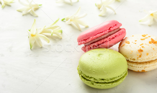 Varicolored macaroons and flowers. Copy space. Stock photo © markova64el